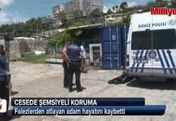 Antalyada cesede şemşiyeli koruma