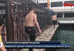 İstanbul'da sıcaktan bunalan gençler elbiseleriyle denize atladı