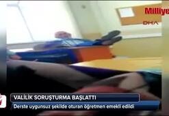 Derste uygunsuz şekilde oturan öğretmen emekli edildi