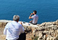Antalyada falezlerde silahlı intihar girişimi