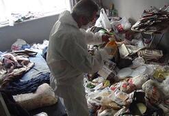 Çöp evden, 22 kilo madeni para ile farelerin parçaladığı 3 bin lira çıktı