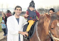 Engelli çocuklar için atla terapi