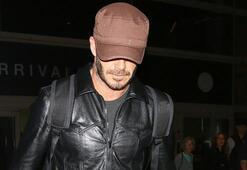 David Beckham yüzünü kapattı