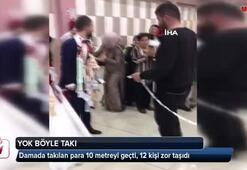 Damada takılan para 10 metreyi geçti, 12 kişi zor taşıdı