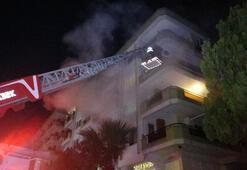 Yangında üst katlarda mahsur kalanları, itfaiye kurtardı