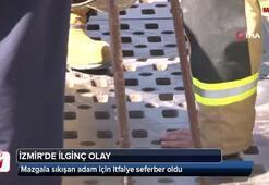İzmirde ilginç olay: Mazgala sıkışan adam için itfaiye seferber oldu