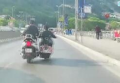 Yakıtı biten motosikleti ayağıyla itti