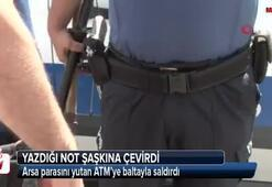 Arsa parasını yutan ATM'ye baltayla saldırdı