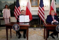 Trump imzaladı Polonyaya ilave bin asker...