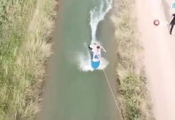 Fenomen gençlerden sulama kanalında sörf