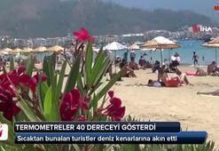 Sıcak havada bunalan tatilciler plaja akın etti