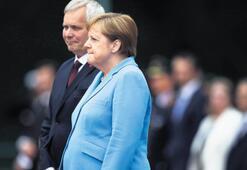 Merkel 3. kez titredi