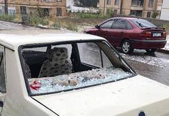 Dolu aracın camını kırdı