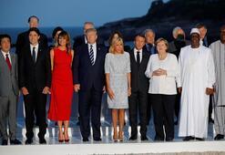 G7de dikkat çeken an Trump ve Macronun eşi...