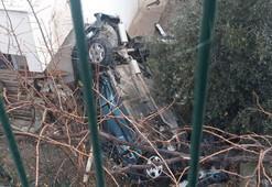 Takla atan otomobil apartmanın bahçesine uçtu